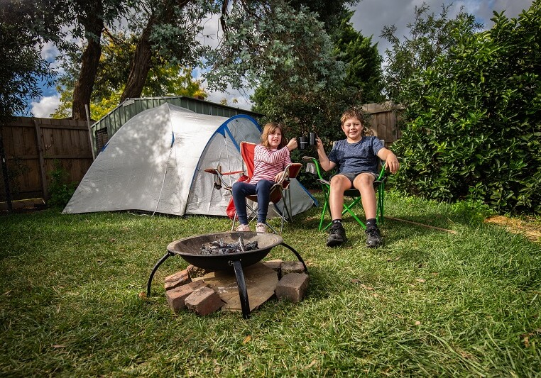 10.04.20 The Age  Booking: 188792 Box Hill Photo shows Archie Smith, 11 and his sister Dana, 8 who have been spending their holidays at home setting up fire pits, drinking tea and doing whittling in their backyard. Photo: Scott McNaughton / The Age